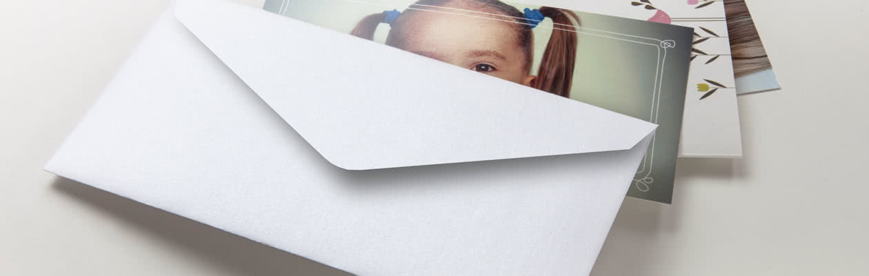 Skicka ditt Fotokort i ett gnistrande vitt kuvert för det lilla extra